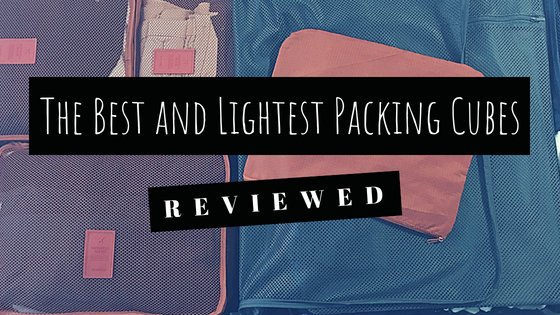 The Best and Lightest Packing Cubes - Reviewed. Photo: open suitcase organized with packing cubes.
